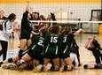 The Seaford girls volleyball team celebrates after winning