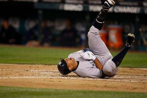 Alex Rodriguez rolls on the ground after being