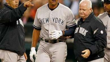 Alex Rodriguez is helped to the dugout after