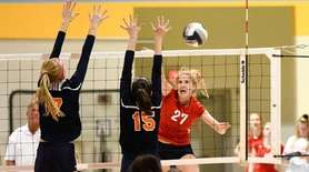 Annaliese Zola of South Side slams the spike