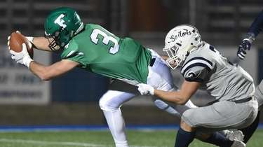 Kevin Wilson #34 of Farmingdale stretches to reach