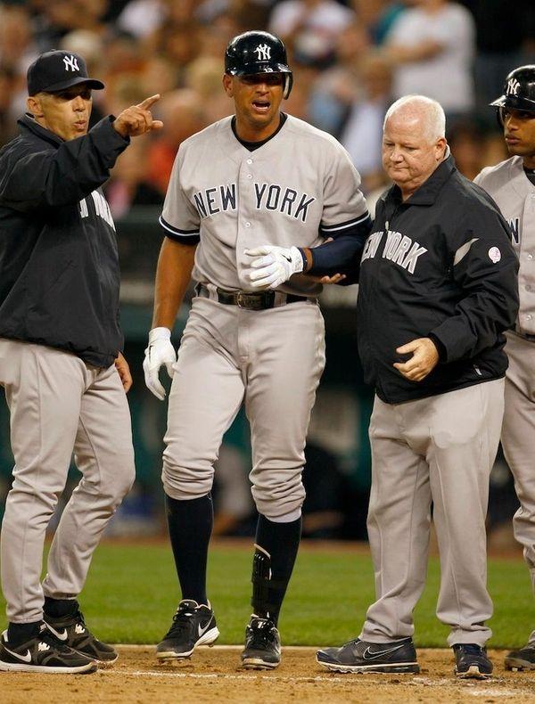 New York Yankees'manager Joe Girardi, left, points as,