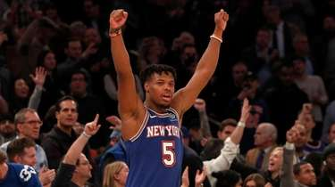Dennis Smith Jr. #5 of the Knicks reacts