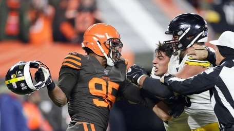Cleveland Browns defensive end Myles Garrett, left, gets