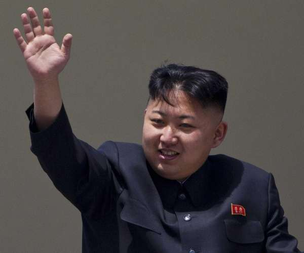 North Korean leader Kim Jong Un waves from