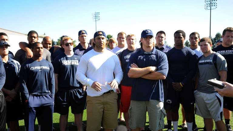 Surrounded by teammates, Penn State senior running back