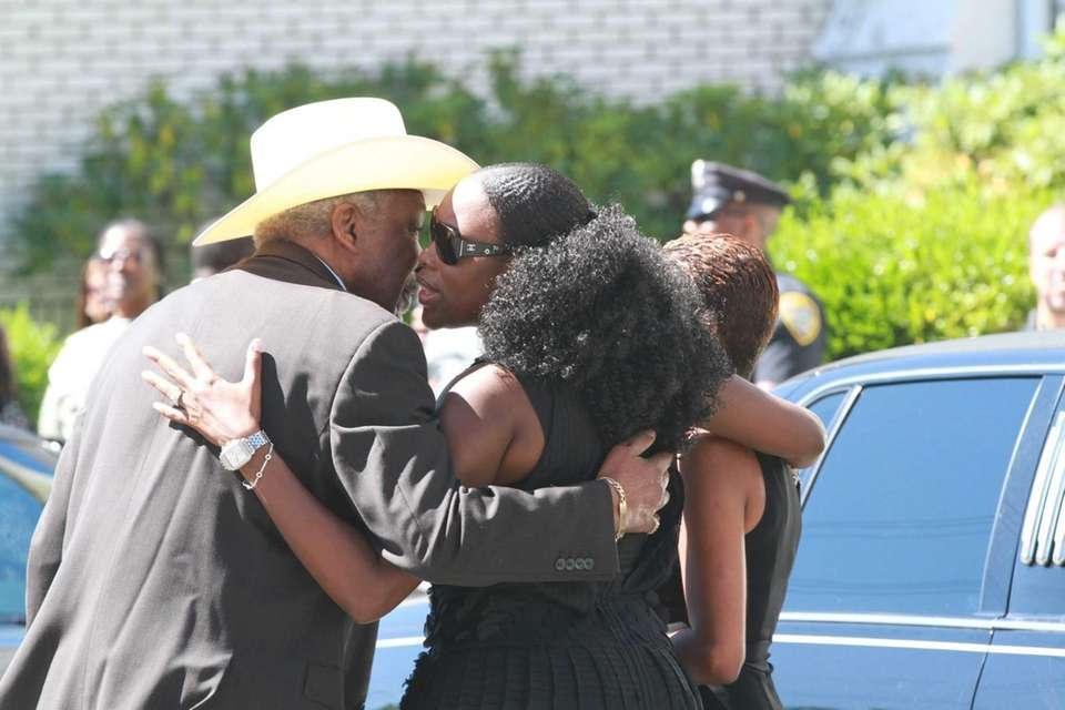 Tren'ness Woods-Black, right, arrives for the funeral of