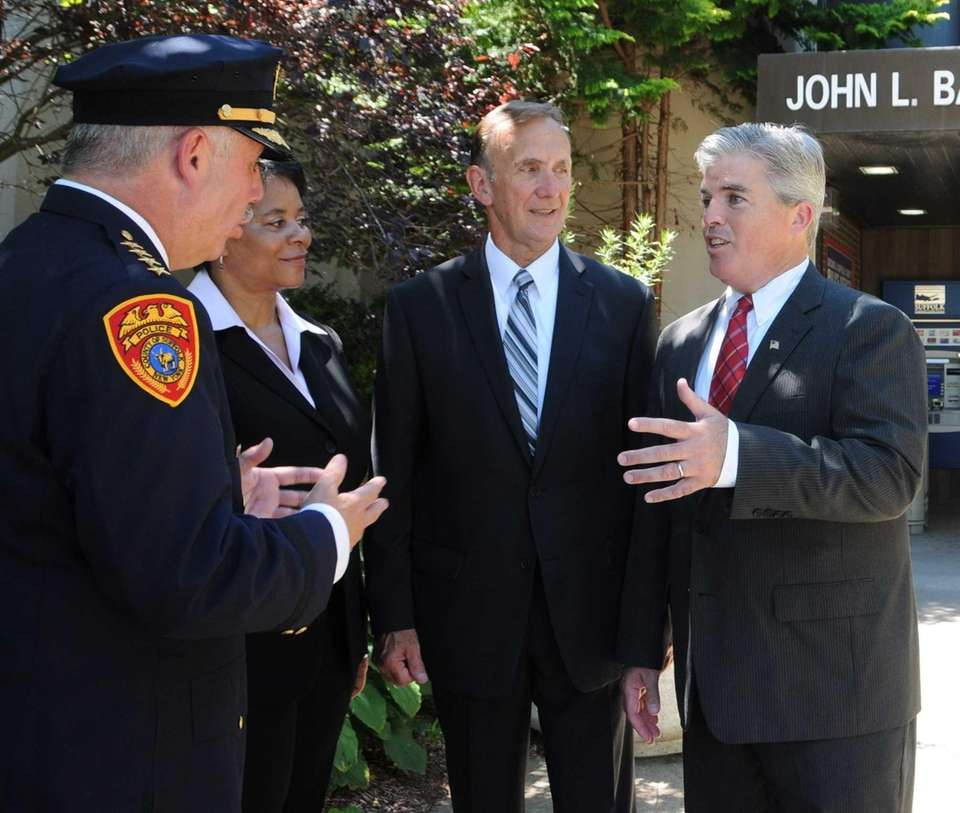 Suffolk County Executive Steve Bellone talks to newly