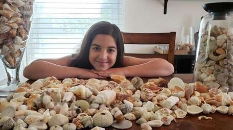 Kidsday reporter Leenoy August with her seashell collection.
