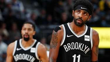 Brooklyn Nets guards Kyrie Irving, front, and Spencer