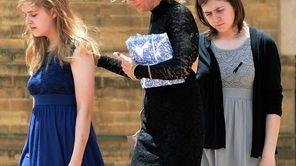 Movie theater shooting victim Gordon Cowden's family walk