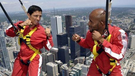 UFC fighters Joseph Benavidez, left, and Demetrious Johnson