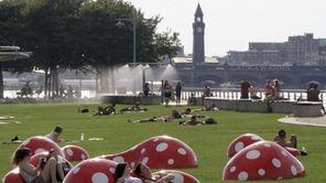 Hudson River Park visitors relax on Japanese artist