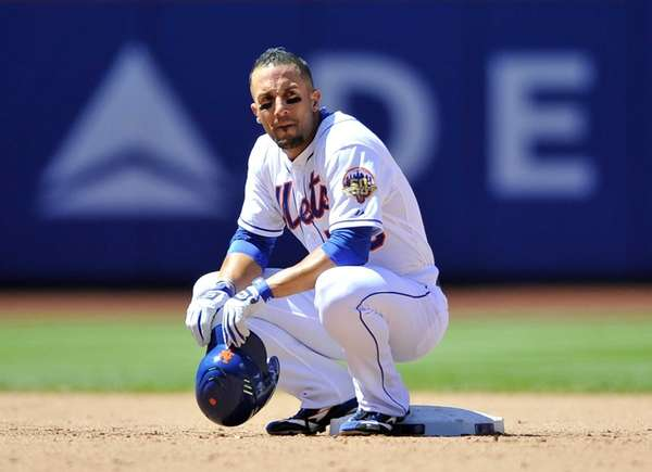 Andres Torres rests at second base during an