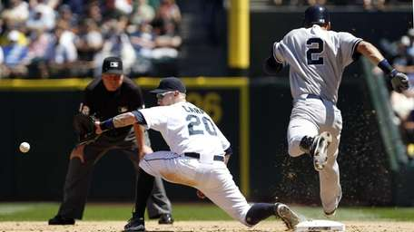 Seattle Mariners first baseman Mike Carp reaches for