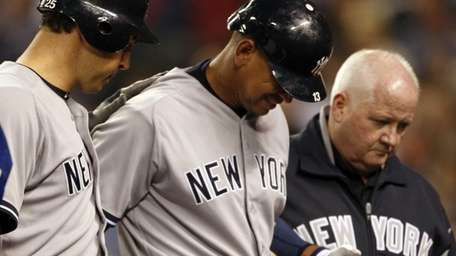 Alex Rodriguez, center, is escorted by teammate Mark