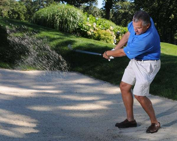 Brookville Country Club member Mike Buccolo poses for