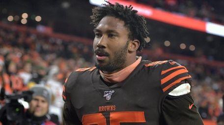 Cleveland Browns defensive end Myles Garrett walks off