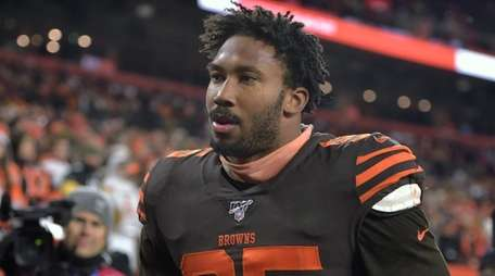 Cleveland Browns defensive end Myles Garrett walks off