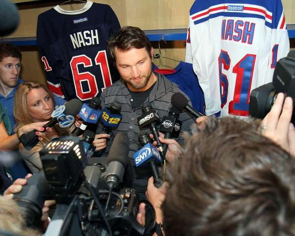 Newly acquired Rick Nash talks to reporters at