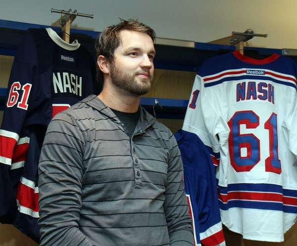 Rick Nash stands with his Rangers uniforms in