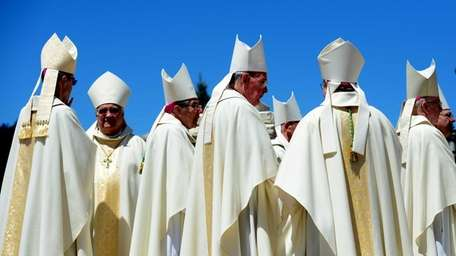 Hundreds of priests and deacons gathered as Rev.