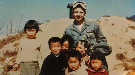 Thomas Nuzzo, 22, top right, with young Korean