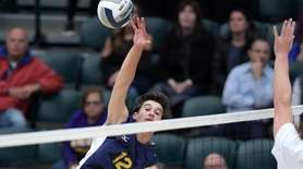 Vincent Colucci of Massapequa hits the volleyball away