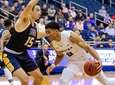 Hofstra guard Tareq Coburn drives on NYIT's Szu