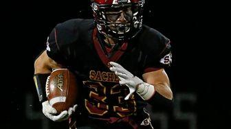 Ryan Paolella #33 of Sachem runs the ball