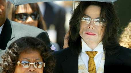 Michael Jackson and his mother Katherine Jackson exit