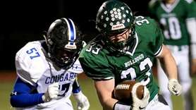 Lindenhurst RB Jack Hogan takes the handoff around