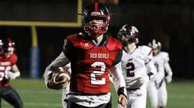 Plainedge's quarterback Daniel Villari outruns all players on