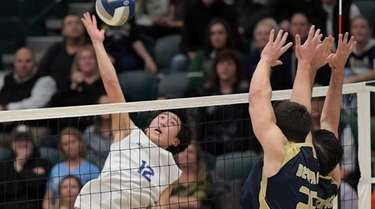 Hunter Bloomer of Long Beach spikes the volleyball