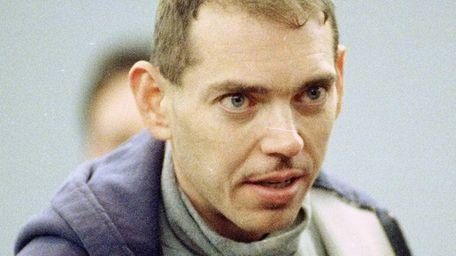John Grega on his way to his arraignment