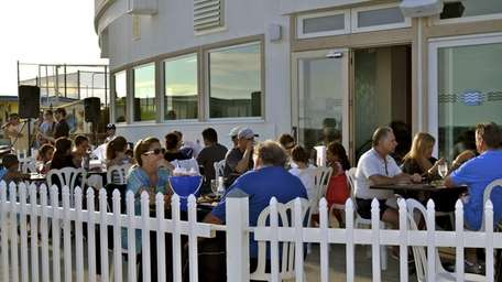 Patrons dining outside The Beach, the new BBQ