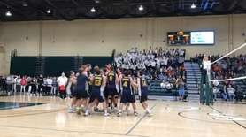 Massapequa celebrates after beating Plainview JFK for the
