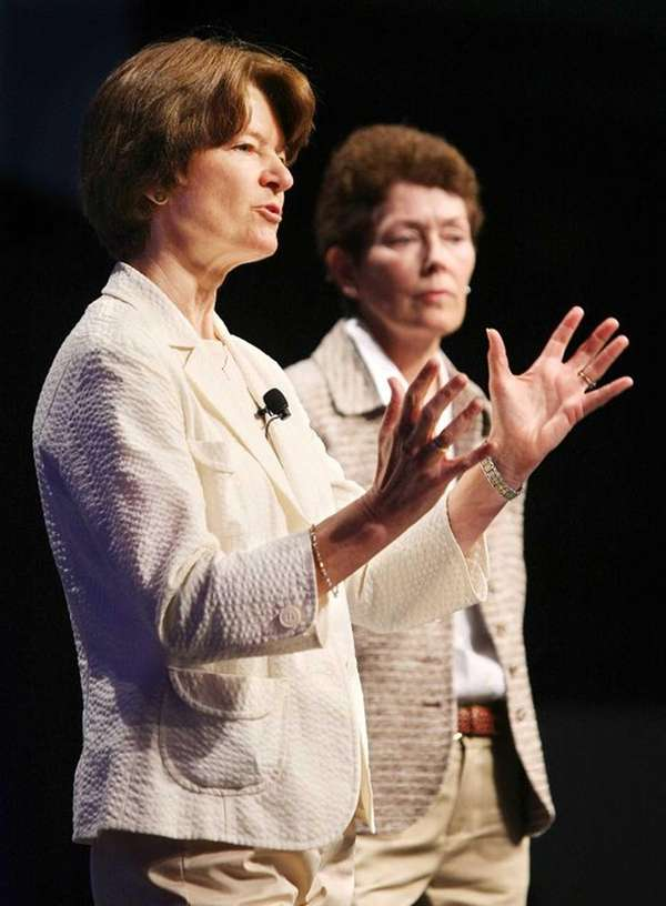 Sally Ride, foreground, and Tam O-Shaughnessy discuss the