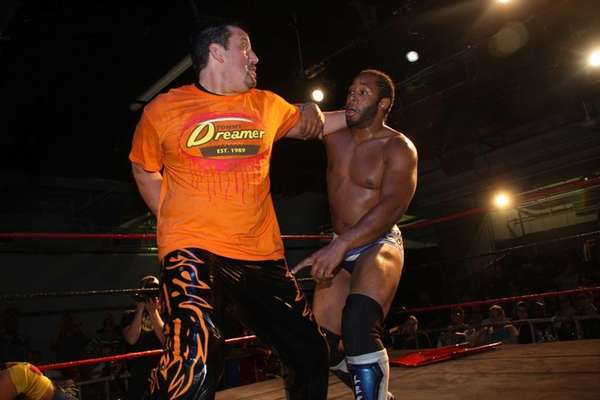 Tommy Dreamer, left, locks up with Jay Lethal
