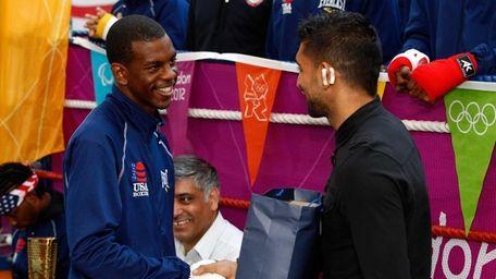 JULY 18: Boxer Amir Khan (R) shakes hands