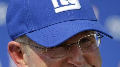 Giants head coach Tom Coughlin answers questions following