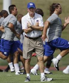 Giants head coach Tom Coughlin, center, looks on