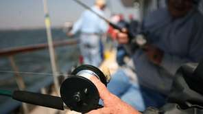 People fish during a half-day fishing trip on