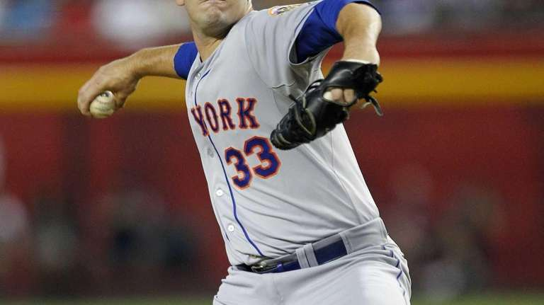 Mets pitcher Matt Harvey delivers a pitch in