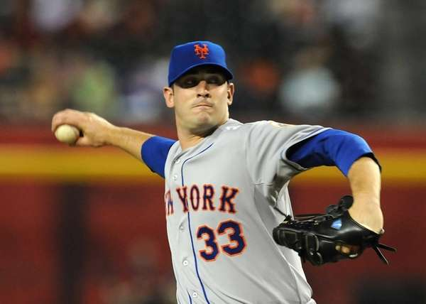 Matt Harvey delivers his first pitch during a
