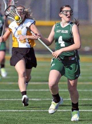 Farmingdale's Samantha Brescia heads up field against Wantagh