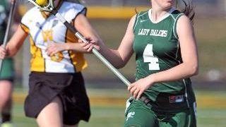 Farmingdale's Samantha Brescia heads up field against Wantagh