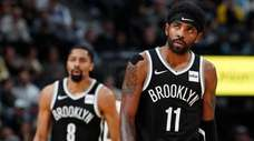 Nets guards Kyrie Irving, front, and Spencer Dinwiddie