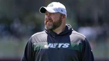 New York Jets general manager Joe Douglas greets
