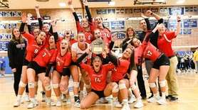 The Connetquot girls volleyball team proudly shows off